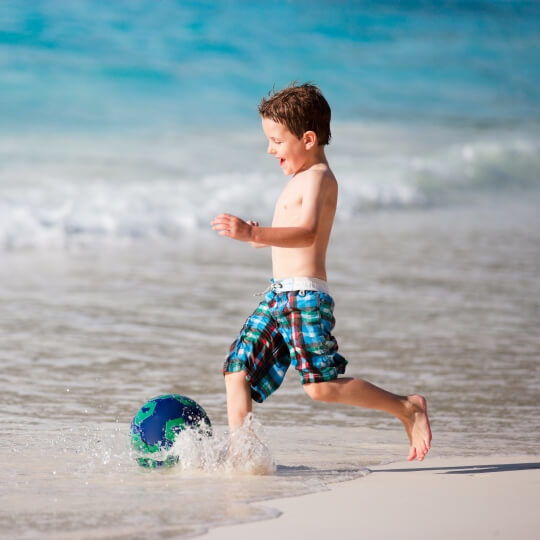 Kid having fun at the beach Avansa Travel